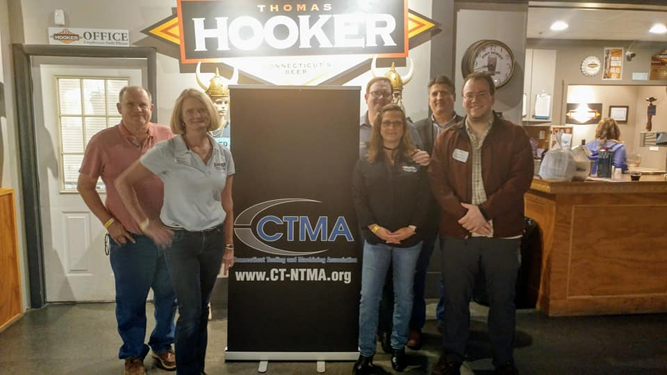 CTMA sign with group shot